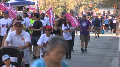 Workers march in solidarity in Toronto labor day parade Stock Footage