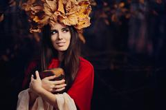 Woman With Autumn Leaves Crown with Treasure Box Stock Photos