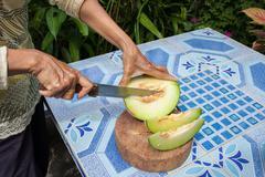 Melon on the table or Cantaloupe salad. Slices of melon on a table Stock Photos
