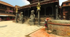 Unknown woman collects water near Dattatreya Temple in Bhaktapur, Nepal. Stock Footage