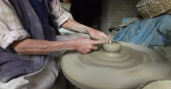 Unidentified Nepalese man working in the his pottery workshop Stock Footage