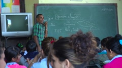 A teacher instructs a classroom of students in Cuba. Stock Footage