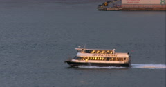 New York Waterway boat passes by large ship on Hudson River in slow motion Stock Footage
