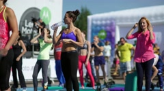 Russia, Novosibirsk, 2016: Rest between sets. Sports girl drinks water Stock Footage