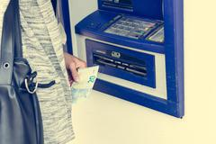Closeup of receiving money from atm. Stock Photos