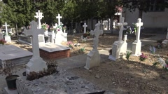 4K Spanish rural graveyard with headstone, old white cross and cypress tree-Dan Stock Footage