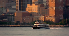 New York Waterway boat in slow motion on Hudson River during sunset Stock Footage