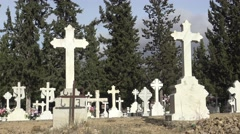 4K Tumbs In A Cemetery with headstone, white cross and cypress in Spain. -Dan Arkistovideo