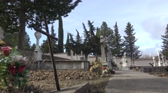 4K Spanish rural graveyard with headstone, old white cross and cypress tree-Dan Arkistovideo