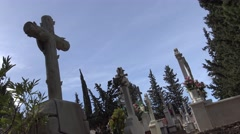 4K Tumbs In A Cemetery with headstone, white cross and cypress in Spain. -Dan Stock Footage