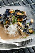Mussels on curry paste Stock Photos