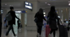 Airplane crew and passengers in the airport terminal Stock Footage