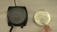 First-person view on chef cooks dough for pancakes Stock Footage