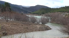 4K Landscape Of Mountains With pines And Dam Remains Or Swamp in Spain-Dan Stock Footage