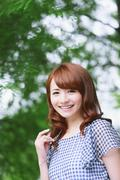 Young attractive Japanese woman in a city park Stock Photos