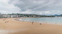 San Sebastian Beach with people walking, Spain. Timelapse Stock Footage