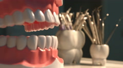 Many dental instruments and jaw. Stock Footage