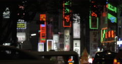 Advertising banners and car traffic in night Seoul, South Korea Stock Footage