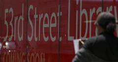 Pedestrians walk past 53rd Street New York Public Library in slow motion Stock Footage