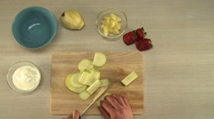 View on chef cutting apple for fruit salad Stock Footage