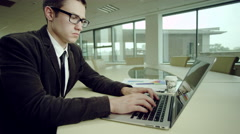 Businessman typing on laptop Stock Footage