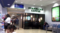 One side of Starbucks store inside shopping mall with 4k resolution Stock Footage