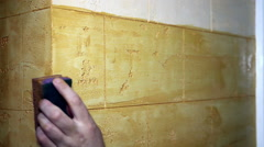 Man's Hand Painting A Wall  With a Sponge Stock Footage