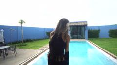 Beautiful seductive brunette woman in a luxurious villa Stock Footage