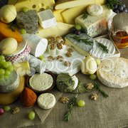 Cheese still life with fruit Stock Photos