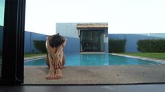 Beautiful brunette bikini woman by the outdoor pool Stock Footage