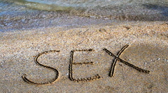 Inscription on sand sex. Stock Footage