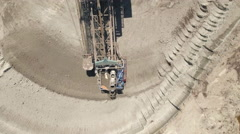 Aerial view of bucket wheel excavator in a lignite open pit mine Stock Footage