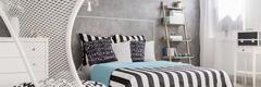 Minimalistic furniture in bedroom interior Stock Photos