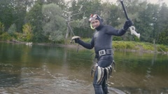 Spear fisherman shows Freshwater Fish at spear of underwater fisherman after Stock Footage