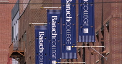 College banners in a row on a hot summer day in New York City Stock Footage