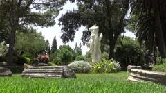 4K Classic Venus statue in the beautiful green garden.  Afrodita Anadyomene -Dan Stock Footage