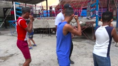 A retired boxer gives boys lessons in the old city of Havana, Cuba. Stock Footage