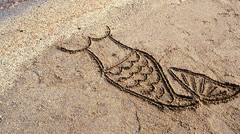 The mermaid's drawing on sand. Stock Footage