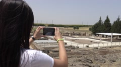 4K, Asian Woman taking photograph with phone of ruins at ancient roman house-Dan Stock Footage