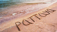 Inscription on sand of Pattaya. Stock Footage