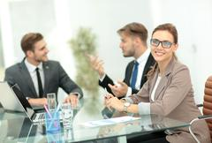 Beautiful modern businesswoman  working with  her colleagues on Stock Photos