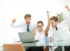Business team celebrating a triumph with arms up Stock Photos