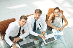Three successful business person. High view Stock Photos