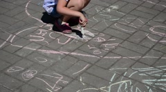 Child draws with chalk. Actions in honor of day of a family Stock Footage