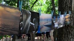 Public photo exhibition in park. Stock Footage