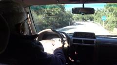 4K Caucasian man driving a car in the dehesa with cork oaks at Badajoz-Dan Stock Footage
