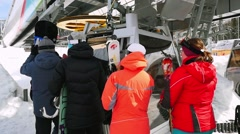 Russia, Sheregesh, 26 march. Tourists are getting ready for skiing Ski resort in Stock Footage