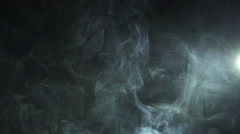 The stream of thick smoke on the background of dark surface. Slow motion capture Stock Footage