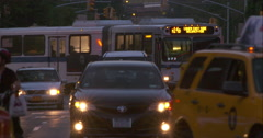 Street traffic in the evening in New York City in slow motion Stock Footage