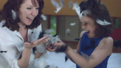 4k Morning Shot of a Woman and child Having Fun with Feathers after Pillow fight Stock Footage